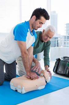 Paramedic training cardiopulmonary resuscitation to man