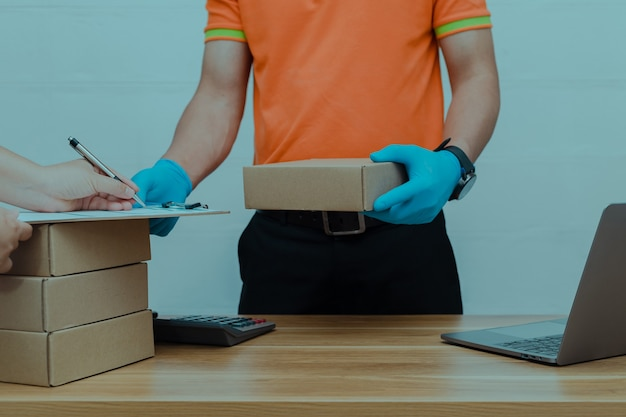A parcel delivery worker counting the parcel boxes