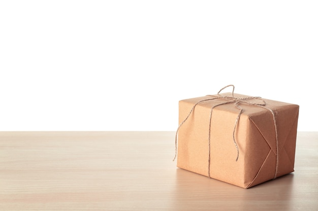 Parcel gift box on table against white background