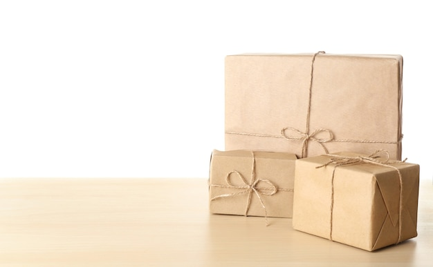 Parcel gift boxes on table against white background