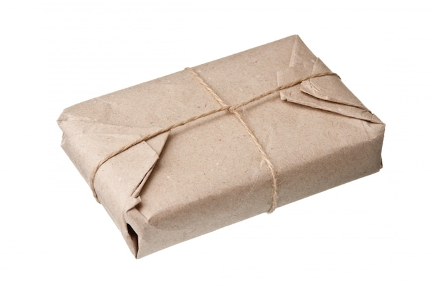 Parcel wrapped with brown kraft paper isolated on white background