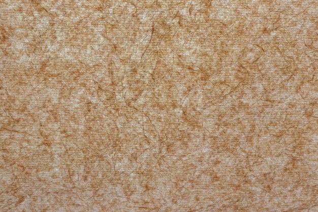 Parchment paper against light, background for design, copy space