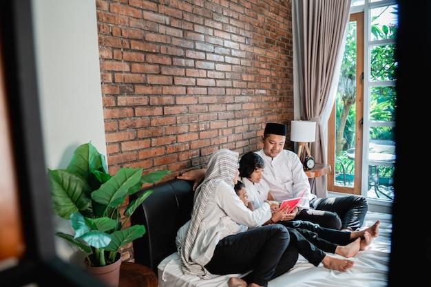 Parent and kids muslim reading quran