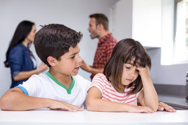 Parents arguing in front of children
