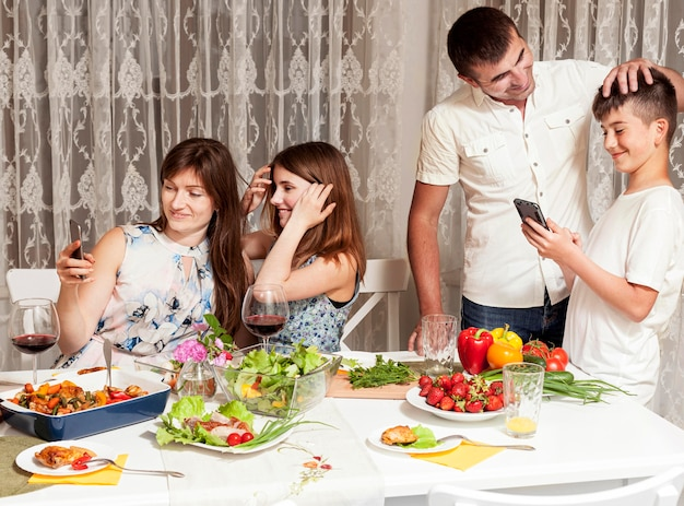 Parents enjoying their time with children at dinner table