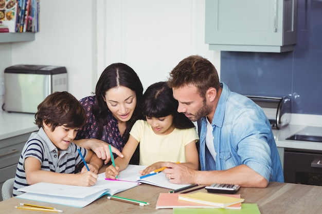 Parents helping children in doing homework