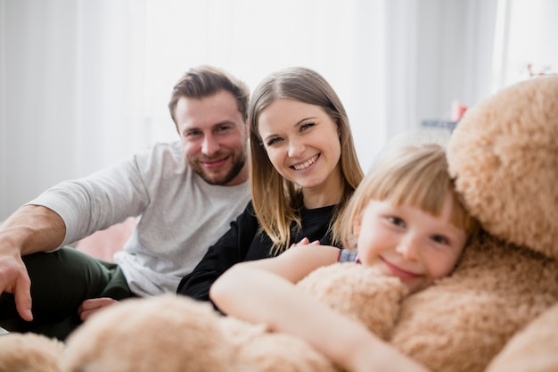 Parents near girl with toy
