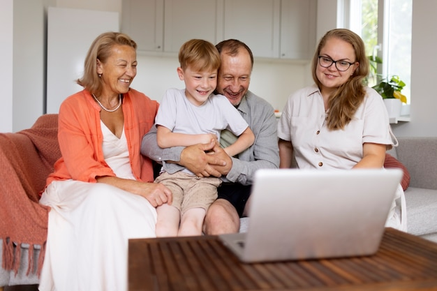 Parents spending time with their daughter and grandson at home