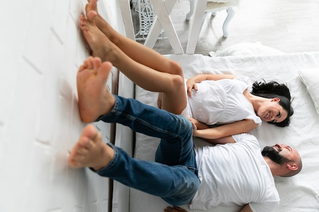Parents staying with their legs on the wall