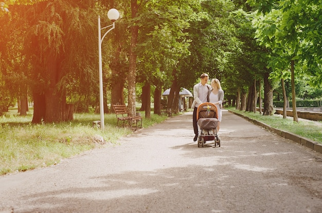 Parents walking their baby in a stroller