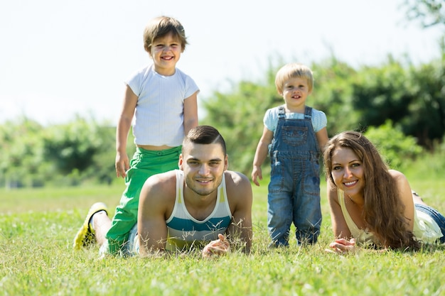 Parents with children laying in the grass