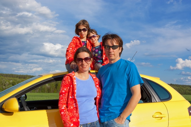 Parents with two kids having car trip