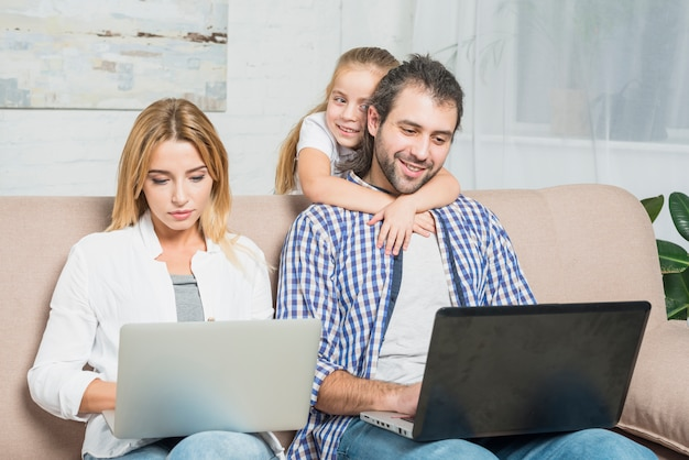 Parents working with laptops