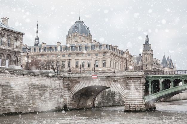 Paris cityscape with river and snow