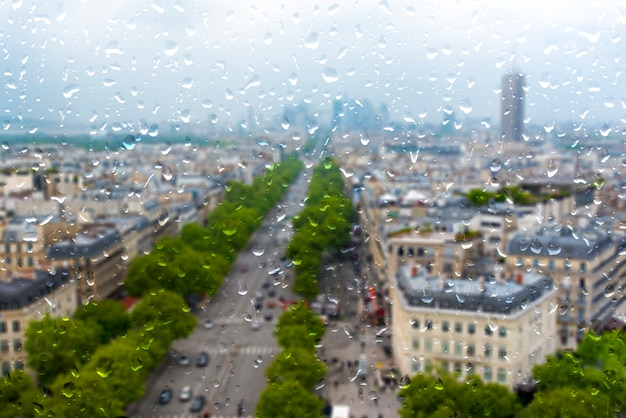 Paris during heavy rain, raining day in paris, drops on the window