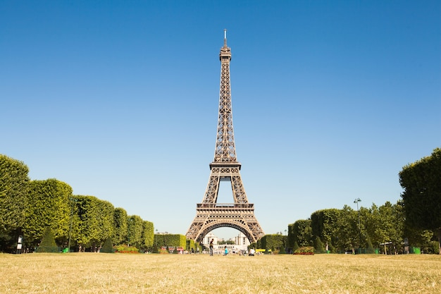 Paris, france - june 19, 2017: view of eiffel tower, view from champ de mars in the morning with a blue sky in a background
