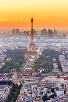 Paris- july 9 : cityscape of paris with eiffel tower from above in orange sunset twilight, on july 9, 2015 in paris france