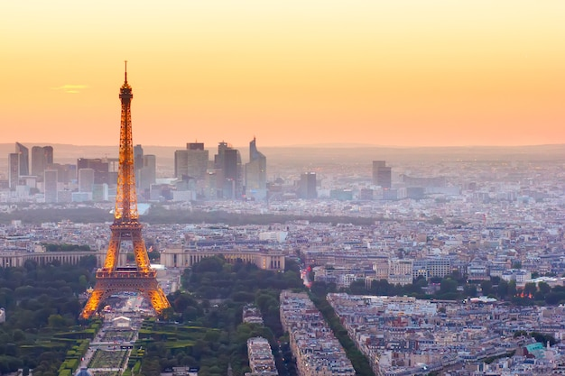 Paris- july 9 : skyline of paris with eiffel tower from above in orange sunset twilight, on july 9, 2015 in paris france