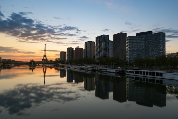 Paris skyline with eiffel tower and seine river in paris, france.