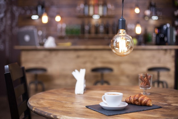Parisian coffee shop style with tasty coffee served on wooden table. coffee shop design.
