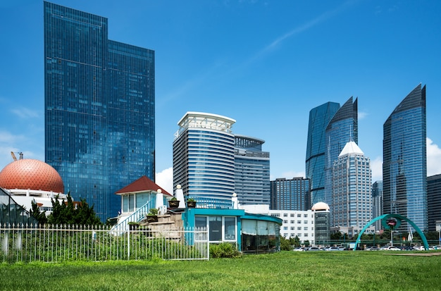 Park lawn and modern urban architecture in qingdao, china