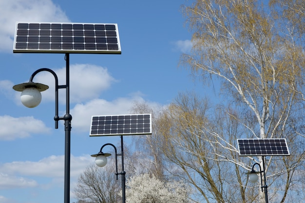 A park with lanterns with solar panels