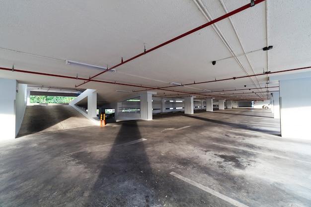 Parking garage interior, industrial building, empty underground interior in apartment