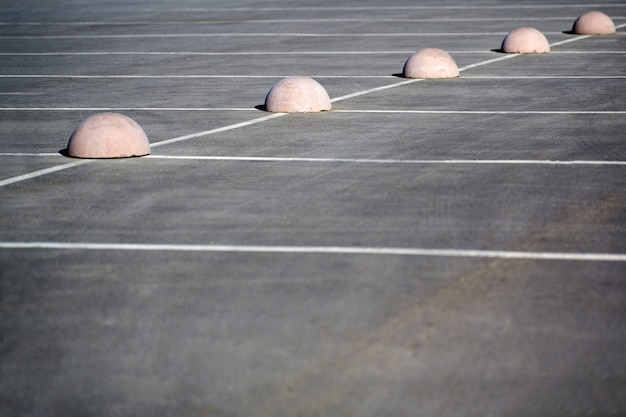 Parking hemispheres. concrete parking limiter. protection from car parking. elements to restrict access to parking zone and control movement of vehicles