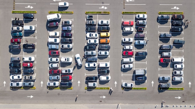 Parking lot with many cars aerial top drone view from above, city transportation and urban concept