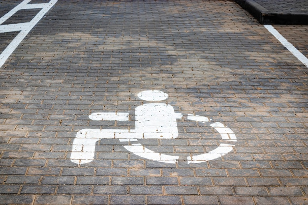 Parking for people with disabilities. a sign indicating a parking place for people with disabilities.