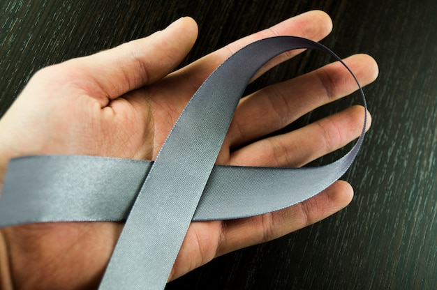 Parkinson's day men's hand with gray tape