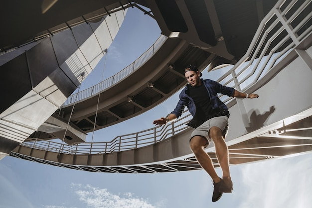 Parkour athlete flying from high attitude