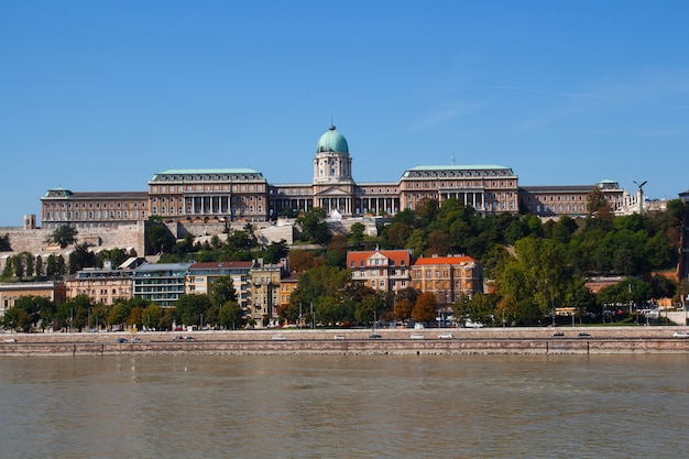 Parliament building in budapest, hungary on a bright sunny day from across the river