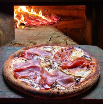 Parma ham pizza baked in the wood oven
