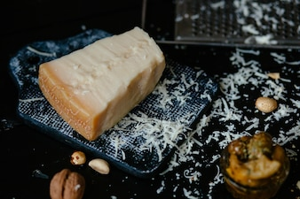 Parmesan cheese. Italian grated parmesan cheese on cutting board