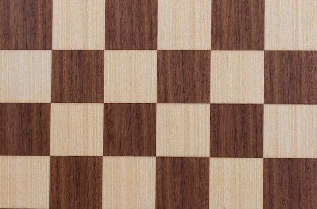 チェスの正方形の寄木細工。フローリングの木の板