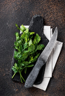Parsley and knife on cutting board