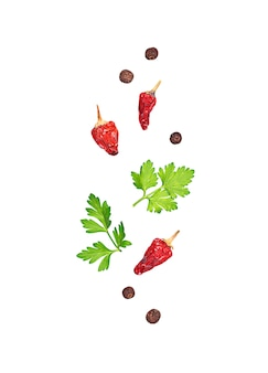 Parsley, red and black pepper isolated on white