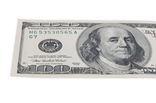 Part of the bill of one hundred american dollars on a white background isolated.