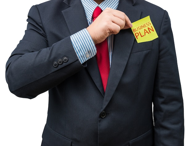 Part of body of business man who takes out yellow notepad