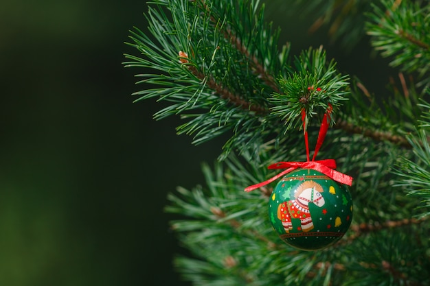 Part of decorated christmas tree with balls closeup