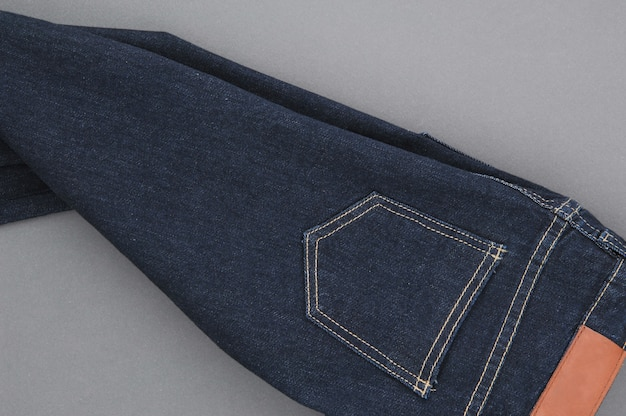 Part of denim pants with back pockets and label