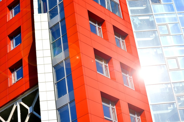 Part of the facade modern building with red and blue