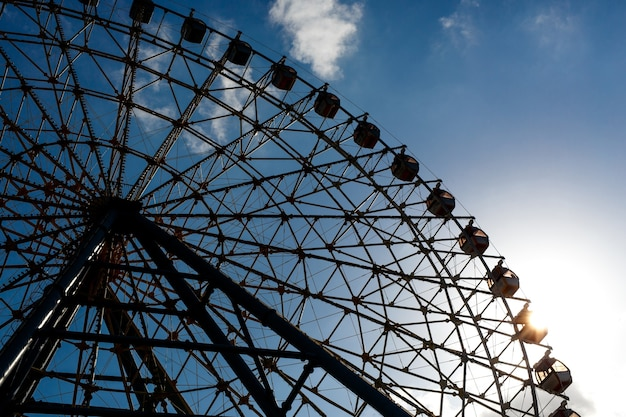 Part of ferris wheel silhouette during sunset