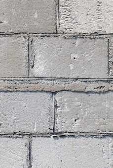 Part of gray wall from old gas silicate blocks, building