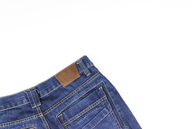 Part of jeans lying on white background. copy space.