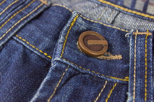 Part of jeans with metal rivet, seams and stitches. clothing, online store concepts.