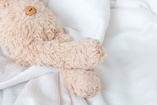 Part of legs teddy bear with feeling relax.