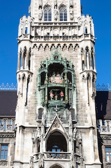 Part of medieval town hall building with spires munich germany.