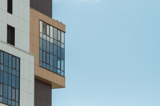 Part of modern residential apartment house building. including a place for copy space. blue sky with clouds
